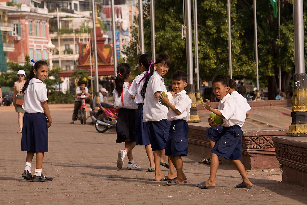 PHNOM PENH, CAMBODIA - OCT 25:  Young school children walk alongside the Tonle Sap River  October 25, 2007 in Phnom Penh, Cambodia. (Photograph by David Paul Morris)