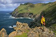 St Kilda, World Heritage Site, tourist on wild cliff edge, Scotland