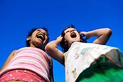 Girlfriends yelling in delight.