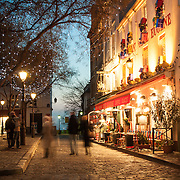 Place du Tertre in Montmartre, Paris at night.