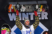 SHOT 1/26/08 4:24:26 PM - Norwegian snowboarder Andreas Wiig (center) from Oslo raises his snowboard in victory on the podium after winning the Snowboard Slopestyle event Saturday January 26, 2008 at Winter X Games Twelve in Aspen, Co. at Buttermilk Mountain. Wiig won the event with a score of 92.00, beating out U.S. riders Kevin Pearce (88.33) and Shaun White (83.33). It was the second year in a row Wiig has won gold in the event. The 12th annual winter action sports competition features athletes from across the globe competing for medals and prize money is skiing, snowboarding and snowmobile. Numerous events were broadcast live and seen in more than 120 countries. The event will remain in Aspen, Co. through 2010..(Photo by Marc Piscotty / WpN © 2008)