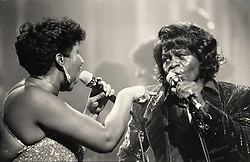Aretha Franklin Died at 76 on August 16, 2018 - James Brown, right, performs with Aretha Franklin in Detroit, Mich., in January 1987. Brown was known as the Godfather of Soul, while Franklin was known as the Queen of Soul. Photo by Richard Lee/Detroit Free Press/TNS/ABACAPRESS.COM