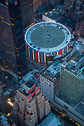"""Madison Square Garden (often called MSG or simply The Garden) is a multi-purpose indoor arena in the New York City borough of Manhattan. Located in Midtown Manhattan between 7th and 8th Avenues from 31st to 33rd Streets, it is situated atop Pennsylvania Station. It is the fourth venue to bear the name """"Madison Square Garden"""", the first two (1879 and 1890) of which were located on Madison Square, on East 26th Street and Madison Avenue, with the third Madison Square Garden further uptown at Eighth Avenue and 50th Street. The Garden is used for professional basketball and ice hockey, as well as boxing, concerts, ice shows, circuses, professional wrestling and other forms of sports and entertainment. It is close to other midtown Manhattan landmarks, including the Empire State Building, Koreatown, and Macy's at Herald Square. It is home to the New York Rangers of the National Hockey League, the New York Knicks of the National Basketball Association, and residency to singer-songwriter Billy Joel. <br /> Opening on February 11, 1968, it is the oldest and most active major sporting facility in the New York metropolitan area."""