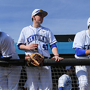 The University of Kentucky's Dorian Hairston, left, Tyler Marshall, center and Bryce Bastien sit in the dugout before their season opener against The University of Virginia. The university of Kentucky faced the University of Virginia in the opening game of the Hughes Brothers Challenge Friday February 14, 2014 at Brooks Field on the campus of the University of North Carolina at Wilmington in Wilmington, N.C. (Jason A. Frizzelle)