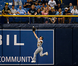 June 10, 2017 - St. Petersburg, Florida, U.S. - Oakland Athletics left fielder JAYCOB BRUGMAN tracks down a deep fly ball hit by Tampa Bay Rays shortstop in the first inning of the second game of a doubleheader between the Oakland Athletics and Tampa Bay Rays at Tropicana Field. (Credit Image: © Loren Elliott/Tampa Bay Times via ZUMA Wire)