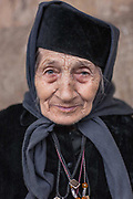 Sometime after her 40th birthday, Grandma Todorka, then a widow and mother of two sons, had a vision of God. She vividly remembers how God told her to give her children up for adoption in a foster home and to dedicate her life to serving the church in her home town, Berkovitsa. Then the church hadn't been functional. But Grandma Todorka followed her vision and did as told. For the next 40 years she helped the church's priest restore the building and open it for the public. She volunteered as a servant in the church until the rest of her life. On these two photographs, Grandma Todorka is 87 years old.<br /> <br /> December 2008
