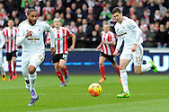Swansea city captain Ashley Williams (l) in action. Barclays Premier league match, Swansea city v Southampton at the Liberty Stadium in Swansea, South Wales on Saturday 13th February 2016.<br /> pic by  Carl Robertson, Andrew Orchard sports photography.