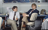 Jim Miklaszewski talks to fellow reporter in the CNN office at the Democratic Convention in San Francisco, CA in July 1984..Photograph by Dennis Brack bs b 17