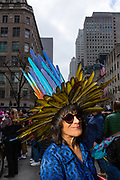 New York, NY - 21 April 2019. An ornate hat apparently made entirely of colorful feathers at the Easter Bonnet Parade and Festival on New York's Fifth Avenue.