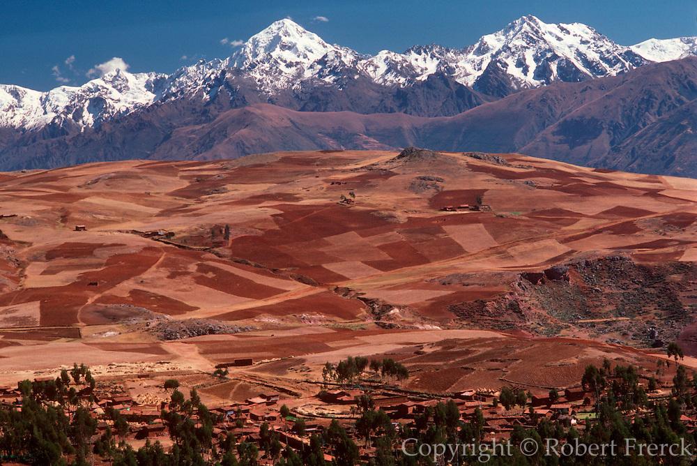 PERU, HIGHLAND, ANDES MOUNTAINS the Cordillera de Urubamba Mtn. s above fields at Maras near Cuzco