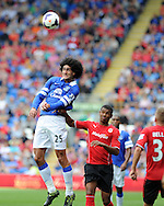 Everton's Marouane Fellaini beats Cardiff's Fraizer Campbell to the ball.  Barclays Premier league, Cardiff city v Everton at the Cardiff city Stadium in Cardiff,  South Wales on Saturday 31st August 2013. pic by Andrew Orchard,  Andrew Orchard sports photography,