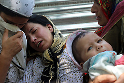 August 21, 2017 - Anantnag, Jammu And Kashmir, India - Wife of Shabir Ahmed Wani wailing over the death of his husband.His dead body was found from his residence,The police officer said that there is a visible axe mark on his head and police registered a case to look into the matter.He said that it could be premature to say whether he was killed by militants or there is other rivalry involved (Credit Image: © Aasif Shafi/Pacific Press via ZUMA Wire)
