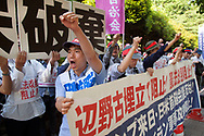 "May 25, 2019, Tokyo, Japan: This students group opposing the President Trump-PM Shinzo Abe summit turned out during a rally of some 5000 demonstrators in front of Japan's National Diet Building (parliament). This occurred just as Trump was arriving Tokyo to attend a four day state visit. Although the focal point of this rally was against the US Marine Corps base construction in Henoko Bay, Okinawa, this group had additional grievances. Wearing red headbands that read ""Danketsu"" or ""Unity"", their message in addition to the Henoko base issue was primarily opposition to Japan-US collaborations and America's threats of war with Iran. They were mostly students from Waseda and Kokugakuin Universities. Photo by Torin Boyd."