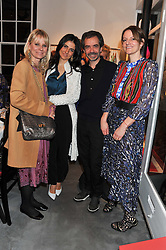 Left to right, ALICE FERRAR, PAULA ?, INACIO RIBEIRO and SUSANNE CLEMENTS at a dinner hosted by Carmen Haid at Atelier Mayer, 47 Kendal Street, London W2 on 21st February 2012.