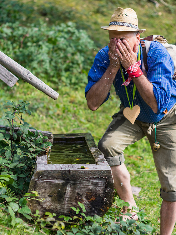 Senior man washing face in Middle Black Forest Baden-Wuerttemberg, Germany