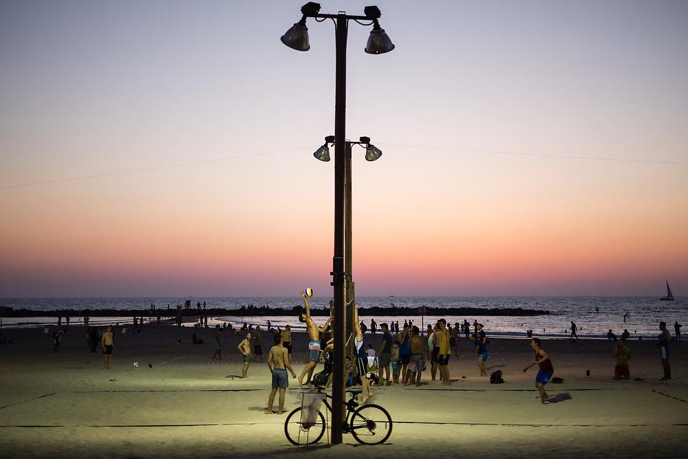 People play beach volleyball at Gordon Beach in Tel Aviv, Israel, on July 21, 2015.