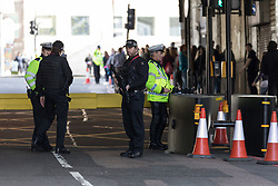© Licensed to London News Pictures. 10/04/2017. LONDON, UK.  Armed police, security bollards and cages outside London Bridge station near Southwark Cathedral in London, where a full police funeral takes place this afternoon for PC Keith Palmer. <br /> PC Keith Palmer was stabbed to death whilst on duty in Westminster by terrorist extremist Khalid Masood last month..  Photo credit: Vickie Flores/LNP