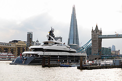 © Licensed to London News Pictures. 04/07/2018. London, UK.  The new 243 feet long superyacht, Elandess arrives in London for the first time ever on the River Thames shortly before mooring at HMS President, the Royal Navy Reserve Unit next to St Katharine Docks and Tower Bridge this evening. Elandess was built at the Abeking and Rasmussen shipyard in Germany, launched in May 2018 and has just completed sea trials ahead of its London visit. Elandess has an axe-bow, dark hull and low-slung superstructure. There are a variety of entertaining communal spaces, from the 8 x 2.5-metre superyacht swimming poollocated on the massive sun deckto the Nemo Loungewith portholesbelow the waterline and an observation lounge on the upper deck. Guest accommodation includes six staterooms, including the master suitewhich is placed forward on the main deck with an observation lounge directly above on the upper deck.  Photo credit: Vickie Flores/LNP