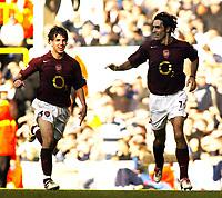Photo: Chris Ratcliffe.<br />Tottenham Hotspur v Arsenal. The Barclays Premiership.<br />29/10/2005.<br />Robert Pires and Cesc Fabregas celebrate the equaliser.