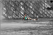 Day Tripper - Paris Louvre  is a  selective colour street photography series by photographer Paul Williams of tourists enjoying a sunny day visit to the Louvre Paris taken on 14th & 15th July 2007. .<br /> <br /> Visit our REPORTAGE & STREET PEOPLE PHOTO ART PRINT COLLECTIONS for more wall art photos to browse https://funkystock.photoshelter.com/gallery-collection/People-Photo-art-Prints-by-Photographer-Paul-Williams/C0000g1LA1LacMD8
