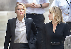 © Licensed to London News Pictures. 24/07/2020. London, UK. American actor AMBER HEARD (L) and lawyer Jennifer Robinson arrive at the High Court in London where Johnny Depp is in a legal dispute with UK tabloid newspaper The Sun over allegations he assaulted his former wife, Amber Heard. Photo credit: Peter Macdiarmid/LNP