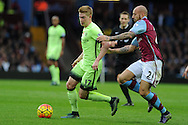Kevin De Bruyne of Manchester city breaks past Alan Hutton of Aston Villa. Barclays Premier league match, Aston Villa v Manchester city at Villa Park in Birmingham, Midlands  on Sunday 8th November 2015.<br /> pic by  Andrew Orchard, Andrew Orchard sports photography.