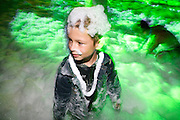 young boy covered in foam at a disco foam party