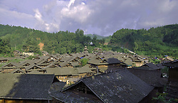 September 14, 2016 - China - Guizhou, CHINA-August 11 2016: (EDITORIAL USE ONLY. CHINA OUT) ..Traditional village of Dong minority group in Congjiang County, southwest China¬°¬Øs Guizhou Province. Dong ethnic minority people are traditionally live on rice with skilled cultivating on famous terraces. It is also an ethnic group skilled in wooden architectures with no nails. The unique wooden architectures of inhabited houses and drum towers are the main features of Dong Minority. A typical Dong house is a three-storey one built on wood pillars; people live in the second floor, and the third floor is used as a storage for food while the first floor is reserved for animals and firewood. (Credit Image: © SIPA Asia via ZUMA Wire)