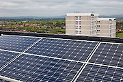 Photo Voltaic (PV) panels on the roof of Kentmere Court, a high-rise tower block in the Charlestown area of Manchester. Northwards housing have dramatically improved the energy rating to thousands of homes they manage for Manchester city council.