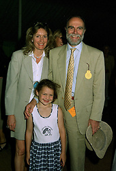 VISCOUNT & VISCOUNTESS COWDRAY and their daughter the HON.CATRINA PEARSON, at a polo match in Sussex on 20th July 1997.MAM 114