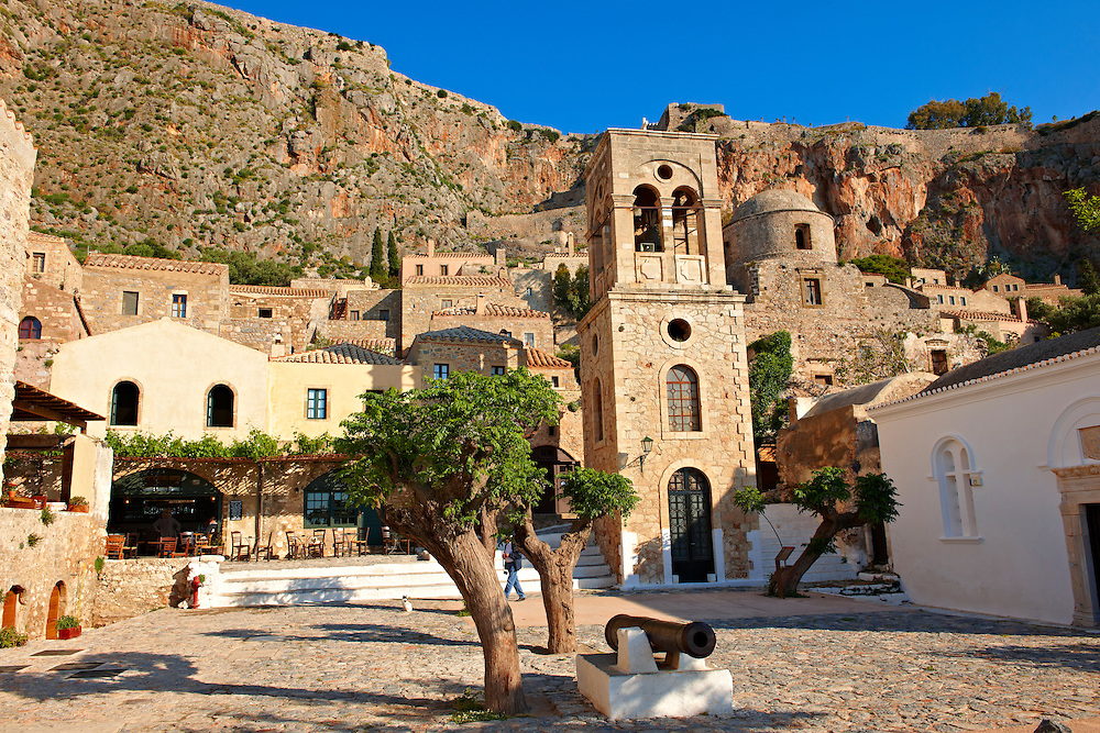 Monemvasia (  ), main square of the lower town with the bell tower of the Byzantine IGreek Orthodox Church of Christ Elkomenos.  Peloponnese, Greece ..<br /> <br /> Visit our GREEK HISTORIC PLACES PHOTO COLLECTIONS for more photos to download or buy as wall art prints https://funkystock.photoshelter.com/gallery-collection/Pictures-Images-of-Greece-Photos-of-Greek-Historic-Landmark-Sites/C0000w6e8OkknEb8 <br /> .<br /> <br /> Visit our MEDIEVAL PHOTO COLLECTIONS for more   photos  to download or buy as prints https://funkystock.photoshelter.com/gallery-collection/Medieval-Middle-Ages-Historic-Places-Arcaeological-Sites-Pictures-Images-of/C0000B5ZA54_WD0s