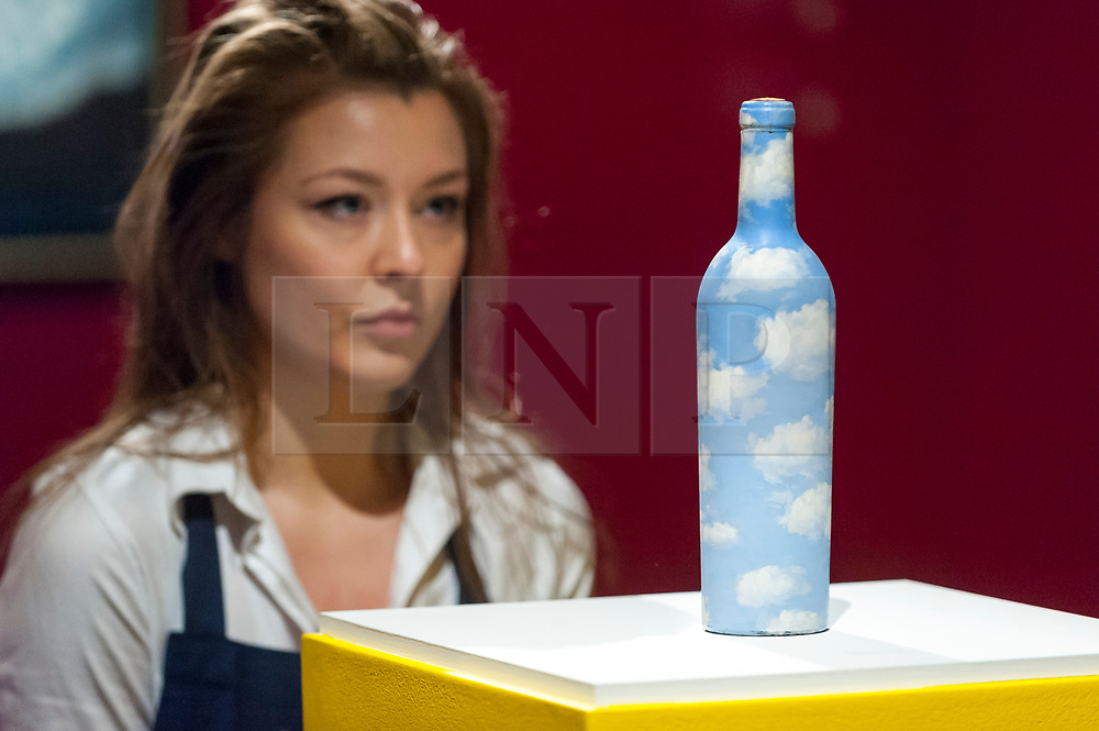 © Licensed to London News Pictures. 22/02/2018. LONDON, UK. A staff member views ''Ciel-Bouteille'' by René Magritte, (Est. £600,000 - 800,000) at the preview of Sotheby's upcoming Impressionist, Modern & Surrealist Art auctions taking place at Sotheby's, New Bond Street, on 28 February. Photo credit: Stephen Chung/LNP