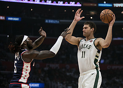 November 10, 2018 - Los Angeles, California, U.S - Brook Lopez #11 of the Milwaukee Bucks is defended by Montrezl Harrell #5 of the Los Angeles Clippers during their NBA game on Saturday November 10, 2018 at the Staples Center in Los Angeles, California. Clippers defeat Bucks in OT, 128-126. (Credit Image: © Prensa Internacional via ZUMA Wire)
