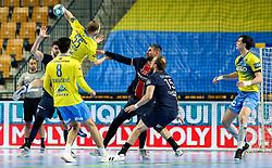 Ziga Mlakar of Celje vs Luka Karabatic of Paris during handball match between RK Celje Pivovarna Lasko (SLO) and Paris Saint-Germain Handball (FRA) in Round of 16 of EHF Champions League 2020/21, on April 1, 2021 in Arena Zlatorog, Celje, Slovenia. Photo by Vid Ponikvar / Sportida