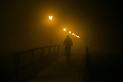 A bike rider rides in the night and fog in Landskrona,Sweden, 20th of August 2016.