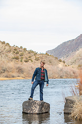 rugged man on a river