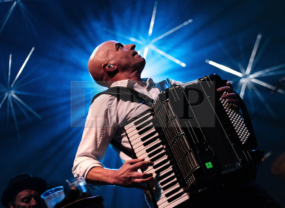 © Licensed to London News Pictures. 20/12/2012. London, UK.   James Fearnley of The Pogues performing live at The O2 Arena for their only UK live date of 2012 as part of their 30th Anniversary Tour.  The Pogues are a Celtic punk band from London, formed in 1982 and fronted by Shane MacGowan.  Members include Shane MacGowan (vocals, guitar, banjo, bodhrán),.Spider Stacy (vocals, tin whistle), Jem Finer (banjo, mandola, saxophone, hurdy-gurdy, guitar, vocals), Andrew Ranken (drums, percussion, harmonica, vocals), .James Fearnley (accordion, mandolin, piano, guitar), .Philip Chevron (guitar, vocals),  Darryl Hunt (bass guitar),.Terry Woods (mandolin, cittern, concertina, guitar, vocals).     Photo credit : Richard Isaac/LNP
