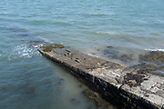 Slipway into the Menai Strait on 16th September 2020 in Bangor, Wales, United Kingdom. The Menai Strait is a narrow stretch of shallow tidal water about 25 km long, which separates the island of Anglesey from the mainland of Wales.