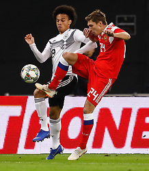 November 15, 2018 - Leipzig, Germany - Leroy Sane (L) of Germany and Kirill Nababkin of Russia vie for the ball during the international friendly match between Germany and Russia on November 15, 2018 at Red Bull Arena in Leipzig, Germany. (Credit Image: © Mike Kireev/NurPhoto via ZUMA Press)