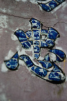 Ceramic chinese characters on the front hall of Quan Cong temple in Hoi An.
