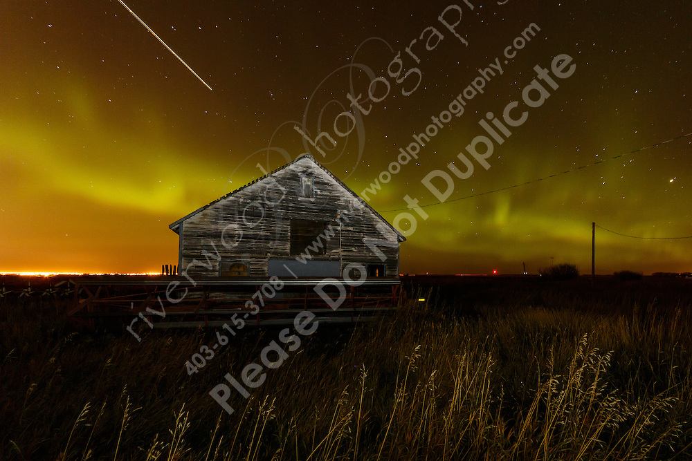 Early in the day I saw an alert that the Aurora Borealis would be active that night but it was cloudy and raining in Calgary at the time. I kept the idea in the back of my head aboout going out for a drive if it cleared up. It didn't look like it was going to happen until after midnight when all of a sudden the clouds around the city lifted. So I packed up my gear and headed east. The aurora got stronger and stronger the entire time I was out there and it seemed like that was going to continue all night. What an amazing thing to watch!<br /> <br /> ©2013, Sean Phillips<br /> http://www.RiverwoodPhotography.com