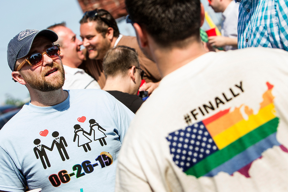 Wes Cayler, left, of Eagan talks with Stacey Roberson of Bloomington before the 2015 Ashley Rukes GLBT Pride Parade in Minneapolis June 28, 2015.  Roberson and a friend designed and ordered the t-shirts the men are wearing within 30 minutes of the Supreme Court decision to legalize gay marriage last week.