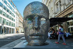 """© Licensed to London News Pictures. 01/06/2021. LONDON, UK. """"Meditation 626"""", 2018, by Seo Young-Deok, made from welded iron chains, is one of 22 public outdoor sculptures installed as part of this year's Mayfair Sculpture Trail and can be seen around Mayfair 2 to 27 June.  The sculpture trail forms part of the eighth, annual edition of Mayfair Art Weekend which celebrates the rich cultural heritage of Mayfair as one of the most internationally known, thriving art hubs in the world with free exhibitions, tours, talks and site-specific installations available to the public.  Photo credit: Stephen Chung/LNP"""