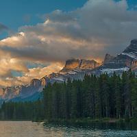 Dawn Light illuminates Mount Rundle, behind Two Jack Lake in Banff National Park, Alberta, Canada.