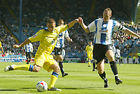 Photo: Aidan Ellis.<br /> Sheffield Wednesday v Leeds United. Coca Cola Championship. 27/08/2006.<br /> Leeds David Healy comes close with this shot as Wednesday's Graham Coughlan makes the challenge
