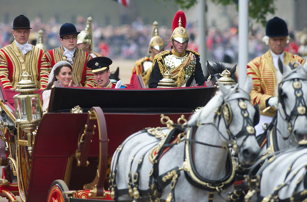 Britain's Prince William and his wife Kate, Duchess of Cambridge ride in a landau to Buckingham Palace after the Royal Wedding in London Friday, April, 29, 2011. (AP Photo/Bogdan Maran)