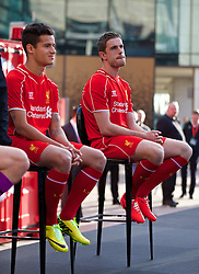 LIVERPOOL, ENGLAND - Thursday, April 10, 2014: Liverpool's Philippe Coutinho Correia and Jordan Henderson at the launch of the new Warrior home kit for 2014/2015 at the Liverpool One shopping centre. (Pic by David Rawcliffe/Propaganda)