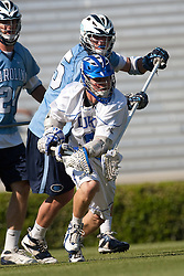 26 April 2009: Duke Blue Devils attackman Max Quinzani (8) checked by UNC defenseman Charlie McComas (45) during a 15-13 win over the North Carolina Tar Heels during the ACC Championship at Kenan Stadium in Chapel Hill, NC.