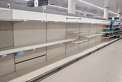 © Licensed to London News Pictures. 13/03/2020. London, UK. Friday lunchtime shoppers find empty shelves , normally filled with toilet paper , at a branch of Waitrose Supermarket in Finchley , North London . Retailers are struggling to replenish essentials , including toilet paper, pasta and hand sanitiser as panic buyers stock up in fear of quarantine measures as the current Coronavirus ( COVID-19 ) spread starts to impact more people . Photo credit: Joel Goodman/LNP