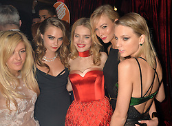Left to right, ELLIE GOULDING, CARA DELEVINGNE, NATALIA VODIANOVA, KARLIE KLOSS and TAYLOR SWIFT at 'The World's First Fabulous Fund Fair' in aid of the Naked Heart Foundation hosted by Natalia Vodianova and Karlie Kloss at The Roundhouse, Chalk Farm Road, London on 24th February 2015.